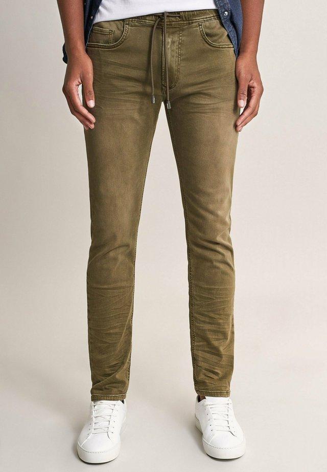 LIMA - Slim fit jeans - grün_