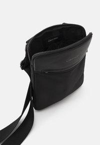 Calvin Klein - FLATPACK UNISEX - Across body bag - black - 2