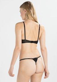 Calvin Klein Underwear - THONG - Thong - black - 2