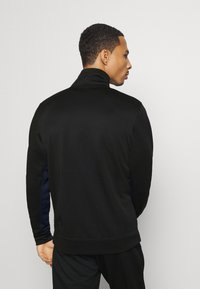 Jack & Jones Performance - JCOZPOLY SUIT BLOCKING - Survêtement - black - 2