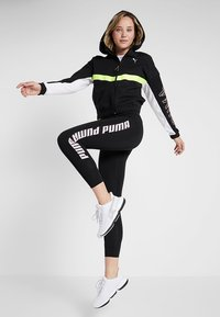 Puma - HIT FEEL IT JACKET - Zip-up hoodie - black/yellow alert - 1