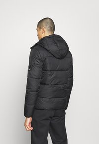 Calvin Klein Jeans - HOODED PUFFER JACKET - Winter jacket - black - 2