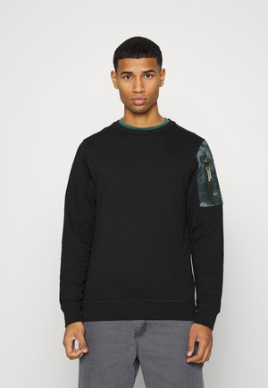 CREW NECK WITH ICONIC ZIP AT LEFT SLEEVE - Sweater - black