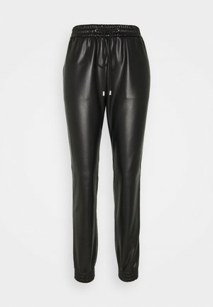 HAJULA - Trousers - black