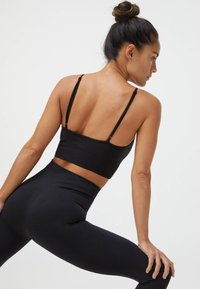 OYSHO - Light support sports bra - black - 3