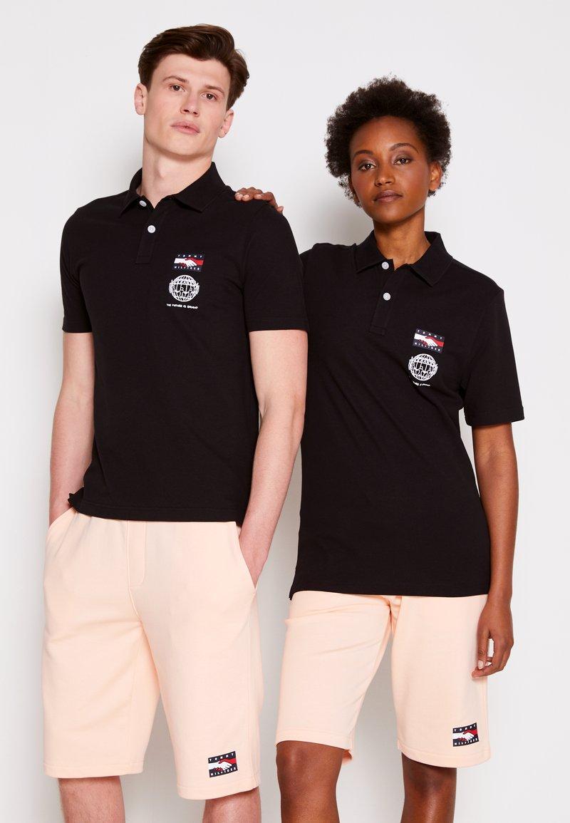 Tommy Hilfiger - ONE PLANET SMALL LOGO UNISEX - Polo shirt - black