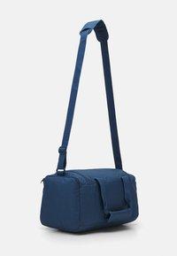 Puma - FUNDAMENTALS SPORTS BAG XS UNISEX - Sports bag - dark denim - 2