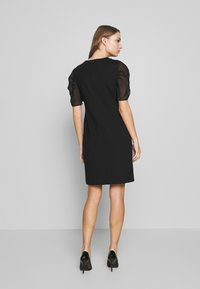 KARL LAGERFELD - SEQUINS DRESS WITH PUNTO - Cocktail dress / Party dress - black - 2