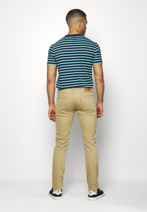 511™ SLIM - Jeansy Slim Fit - harvest gold