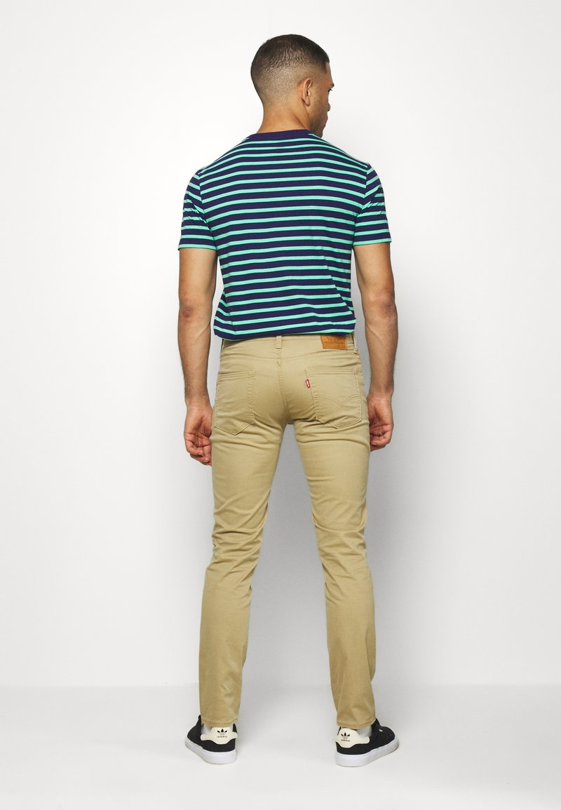 Levi's® - 511™ SLIM - Jeans slim fit - harvest gold
