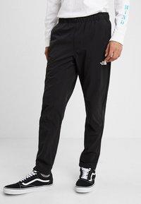 The North Face - TECH PANT - Spodnie treningowe - black/white - 0