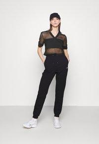 Fila - NIVEO CROPPED - Print T-shirt - black - 1