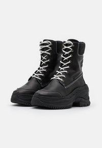 Bronx - CHAINY - Platform ankle boots - black/winter white - 2