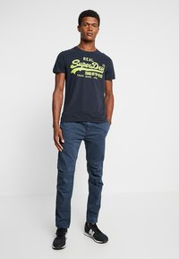 Superdry - CORE UTILITY PANT - Trousers - drift blue - 1