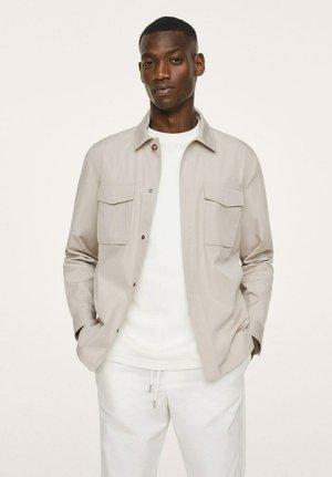 À POCHES - Summer jacket - beige