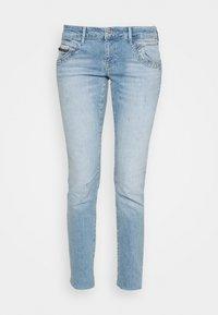 LINDY - Slim fit jeans - destroyed denim