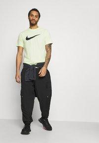 Nike Sportswear - ANORAK  - Windbreaker - black - 3