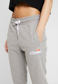 Ellesse - FRIVOLA - Tracksuit bottoms - grey