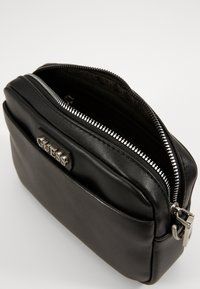 Guess - DAN SMALL NECESSAIRE - Across body bag - black - 2