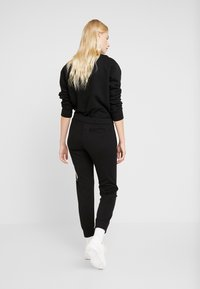 Calvin Klein Jeans - MIRRORED MONOGRAM PANT - Teplákové kalhoty - black - 2
