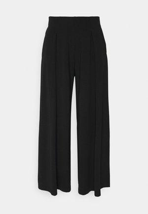 USSITA - Kalhoty - schwarz