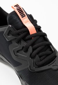 Puma - ZONE XT PEARL - Sports shoes - black/energy peach - 5