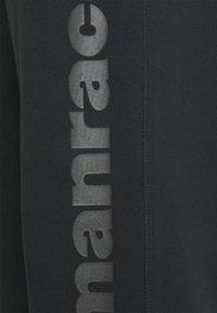 adidas Originals - PHARRELL UNISEX - Tracksuit bottoms - black - 2