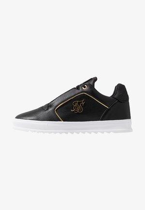 STORM - Zapatillas - black/gold