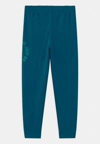 Nike Sportswear - UNISEX - Pantalones deportivos - green abyss - 1
