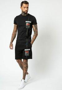 Religion - Shorts - black - 1