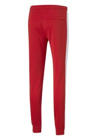 Puma - ICONIC - Tracksuit bottoms - high risk red - 3