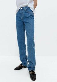 Uterqüe - Straight leg jeans - blue denim - 0