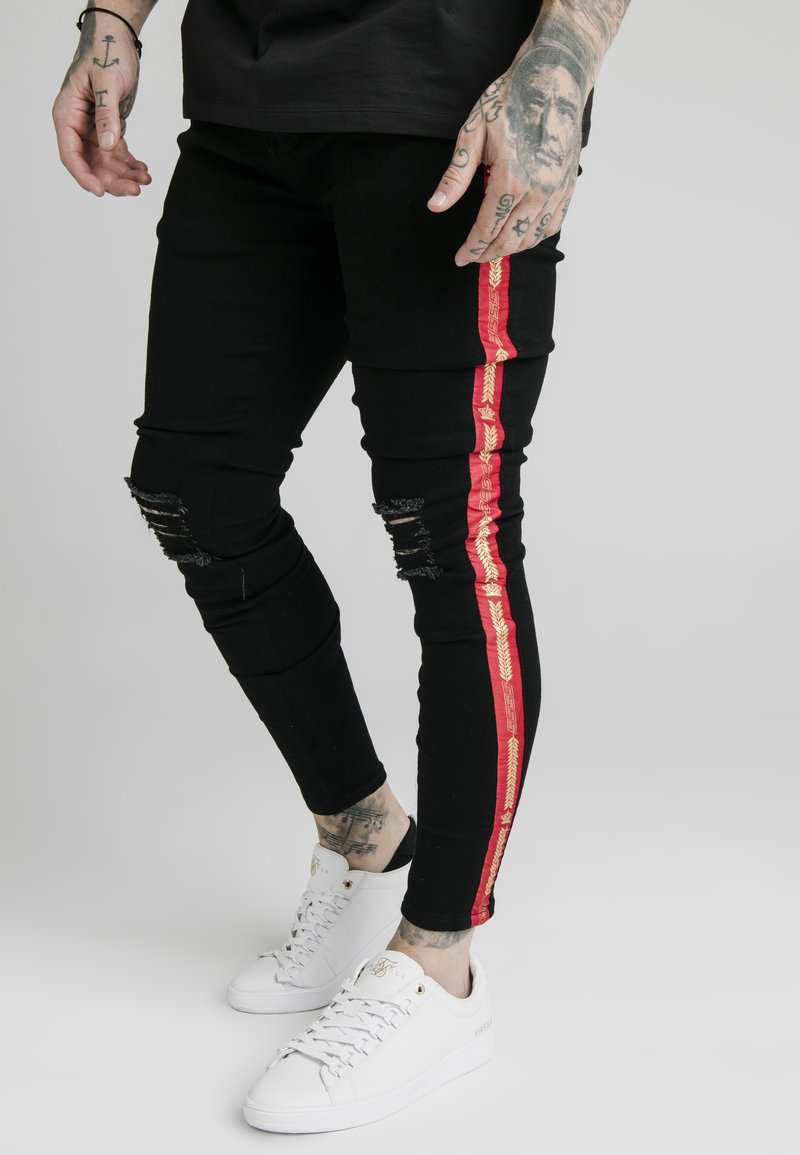 SIKSILK - BURST KNEE - Vaqueros pitillo - black
