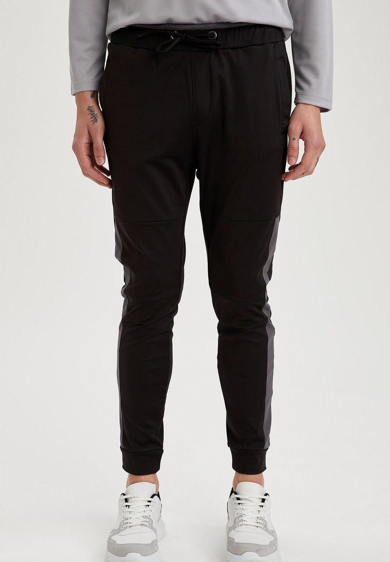DeFacto Fit - Tracksuit bottoms - black