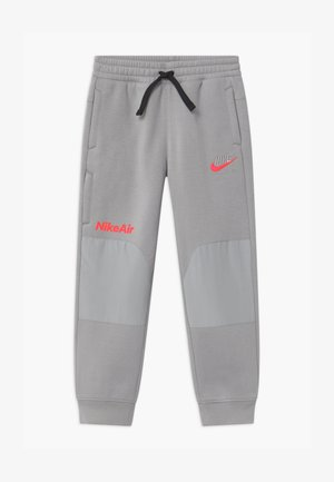 AIR UNISEX - Tracksuit bottoms - smoke grey
