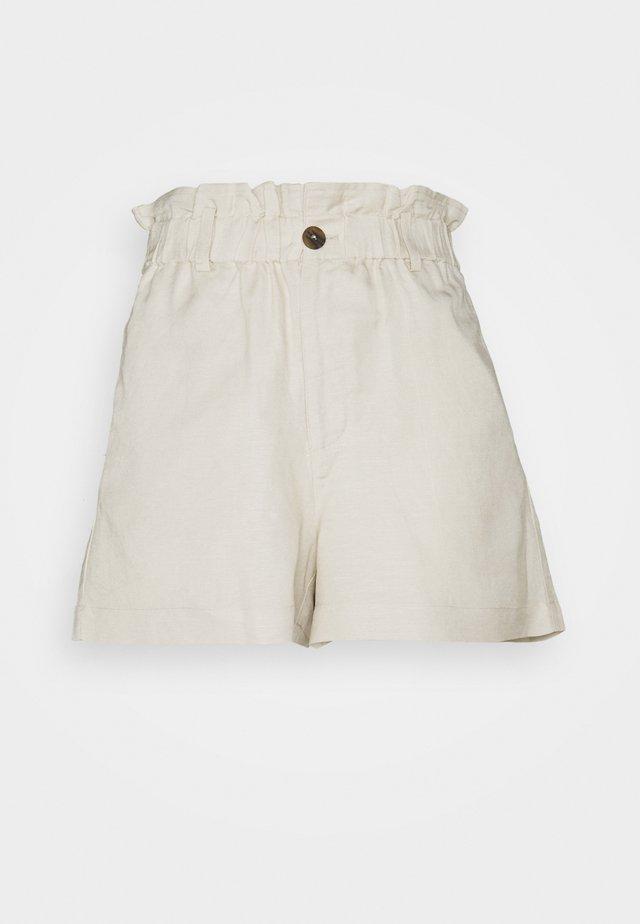 JAZLYN - Shorts - beige