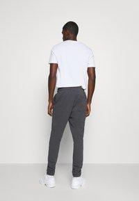 YOURTURN - Loose Fit UNISEX - Tracksuit bottoms - dark grey - 2