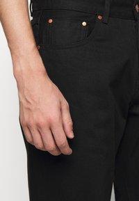 Han Kjøbenhavn - Relaxed fit jeans - black - 5