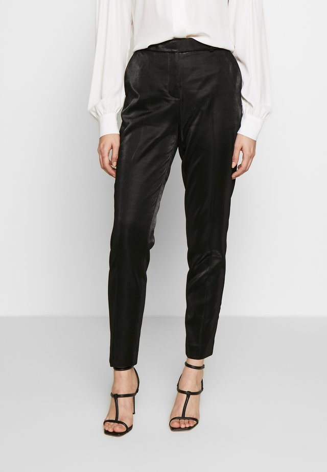 CLAUDIA - Trousers - black