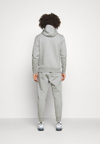 Calvin Klein Golf - PLANET - Tracksuit bottoms - grey - 2