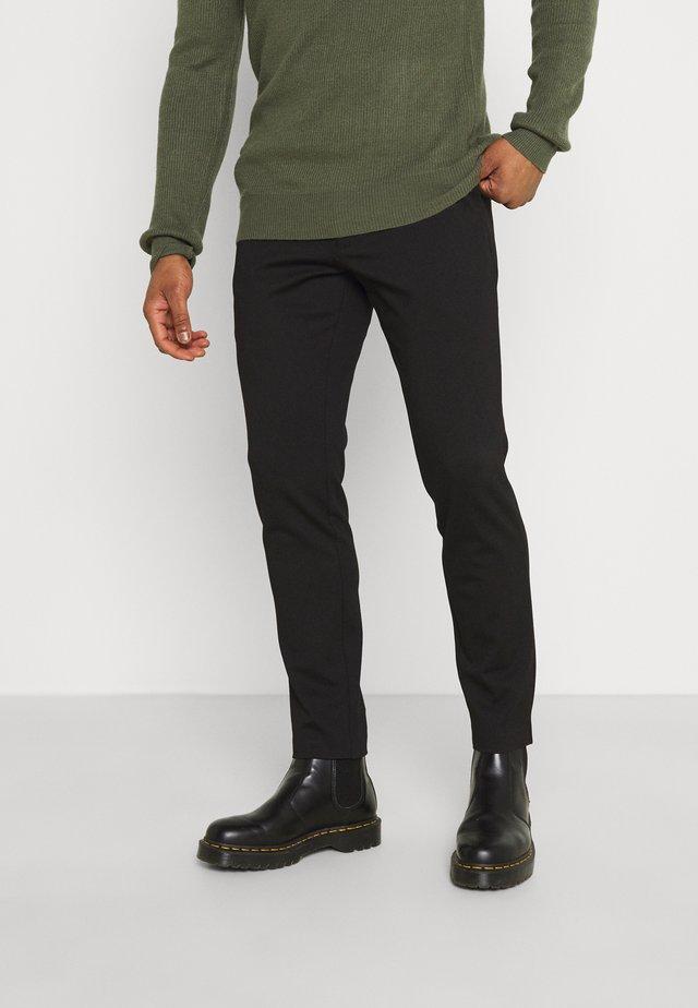 PRINCE PANTS - Pantalones - black