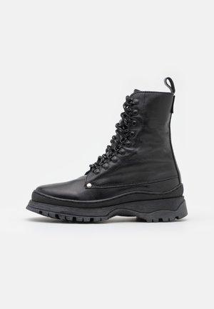 TESFA BOOTS UNISEX - Platform-nilkkurit - black