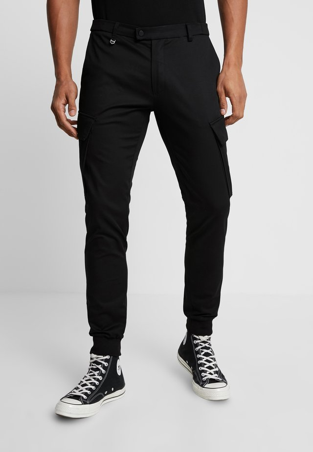 PANT ON BOTTOM LEGS - Cargo trousers - black