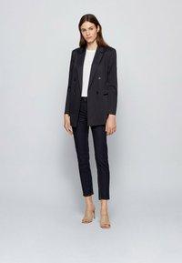 BOSS - CROP - Slim fit jeans - dark blue - 1