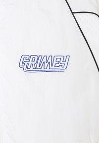 Grimey - UBIQUITY TRACK JACKET UNISEX - Träningsjacka - white - 3