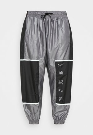 W NSW PANT WVN ARCHIVE RMX - Tracksuit bottoms - black/white