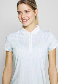 Calvin Klein Golf - SUNRAY  - Polo shirt - aqua/white - 3