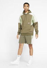 Nike Sportswear - Shorts - medium olive/oil green/light bone/white - 1