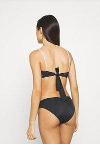 Calvin Klein Swimwear - CORE LOGO TIES BRALETTE - Horní díl bikin -  black - 2