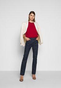 Victoria Victoria Beckham - WORD SEARCH UPSTATE - Flared Jeans - dark blue - 1